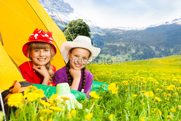 Smiling girls in tent