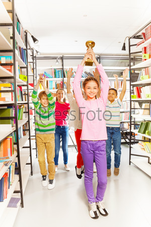 Happy girl holds cup and kids jumping behind