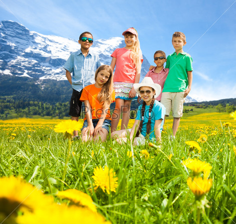 Kids in the mountains flower field