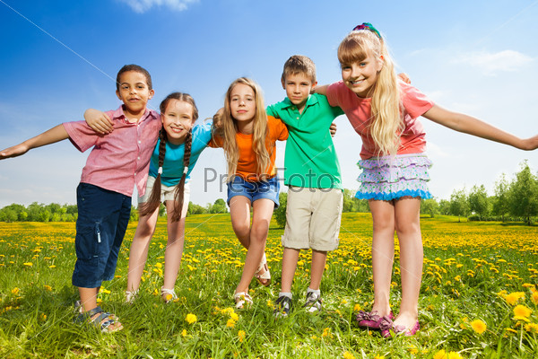 Kids hugging standing in the field