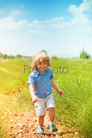 Green field and running boy