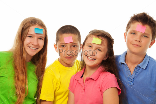 Four kids with stickers on forehead