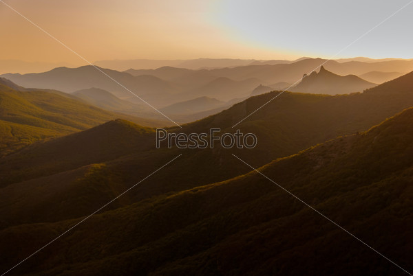 Sunset in the wooded mountains