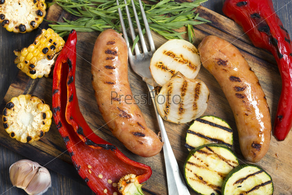 Sausages and grilled vegetables closeup.