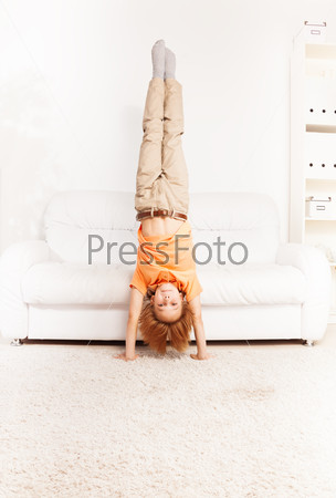 Boy standing on hands