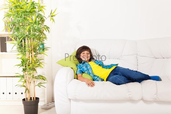 Boy resting on sofa