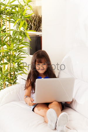 Long haired girl with laptop
