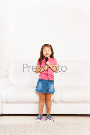 Cute Asian girl with microphone