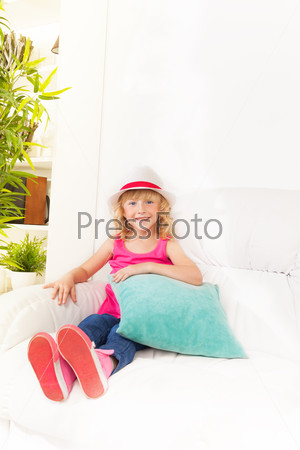Little girl with pillow and hat