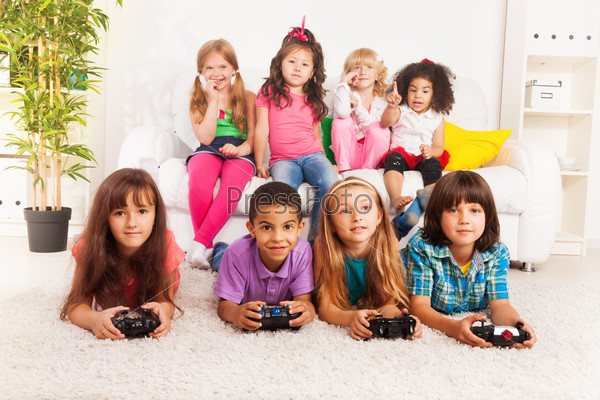 Group of little kids playing video game