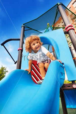 Happy boy sliding