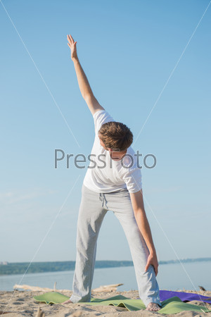 Man practices yoga