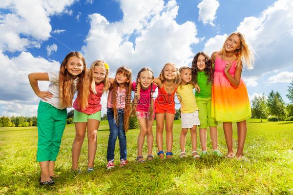 Row of beautiful little girls