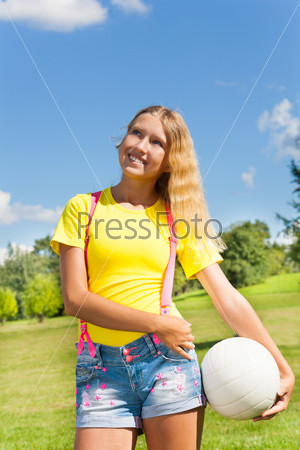 Happy girl with volleyball ball