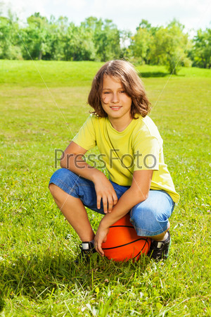 Basketball player after game rest on grass