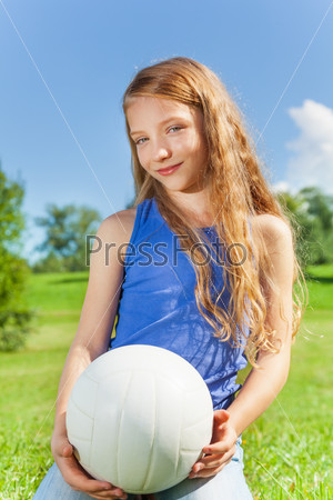 Happy girl holds ball