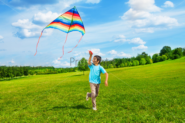Happy boy run with kite