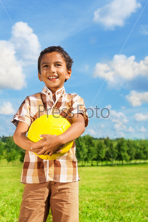 Boy holding yellow volleyball