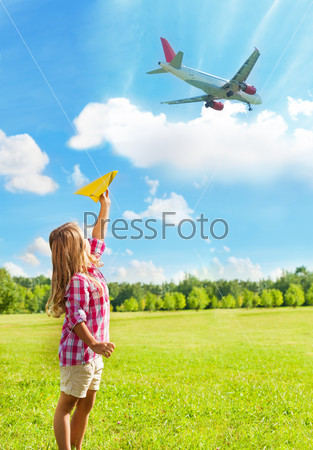 Little girl and airplanes near airport