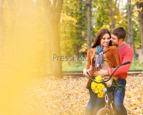 Happy young couple with bicycle
