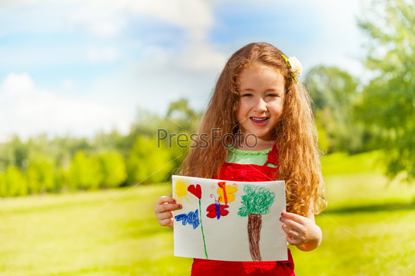 Girl shows her painting