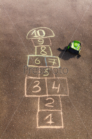 Hopscotch game drawn on the asphalt