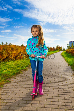 Girl with pink scooter