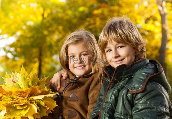Boy and girl autumn portrait