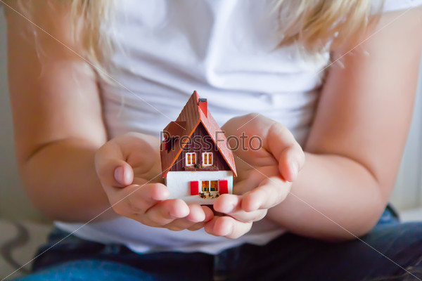 Dollhouse in human hand