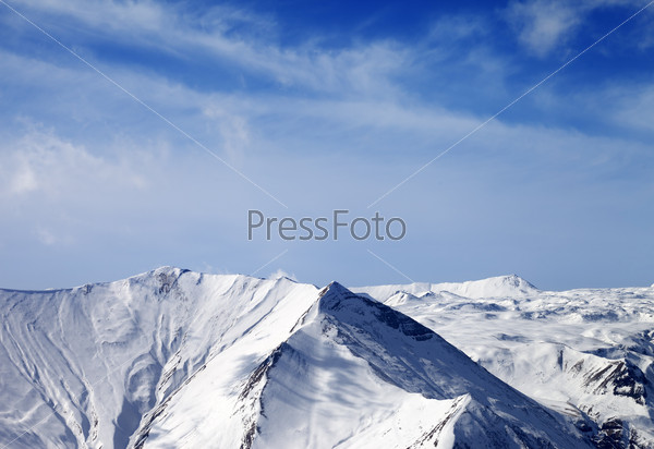 Snowy mountains at sunny day