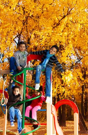 Many kids on climbing frame