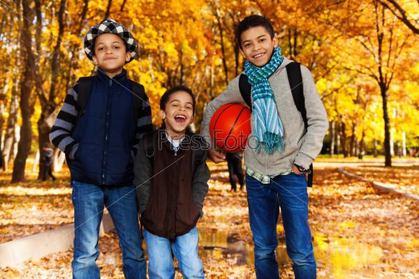 Black boys with basketball ball