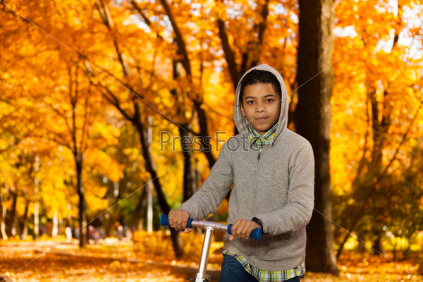 Portrait of boy with scooter