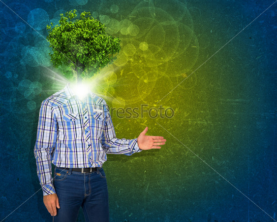 Man stand with green tree instead his head
