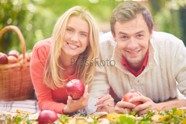 Couple with apples