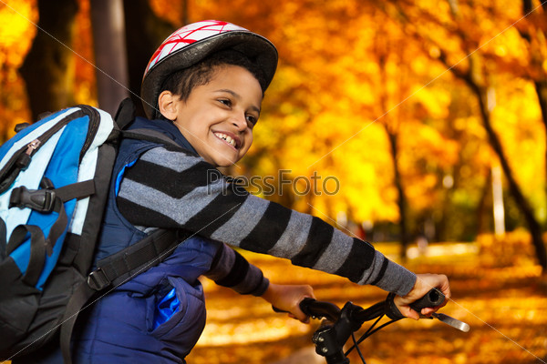 Riding to school on a bike