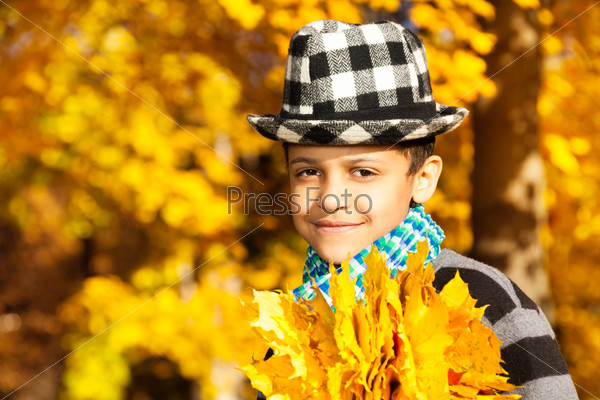 Boy in hat with maple leaves