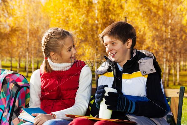 School boy and girl talking