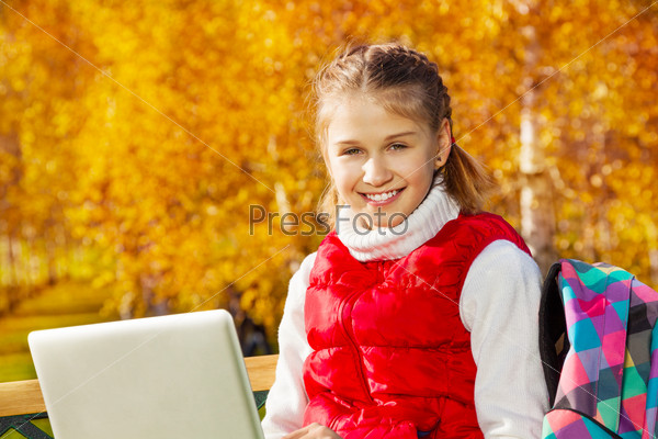 Portrait of girl with computer