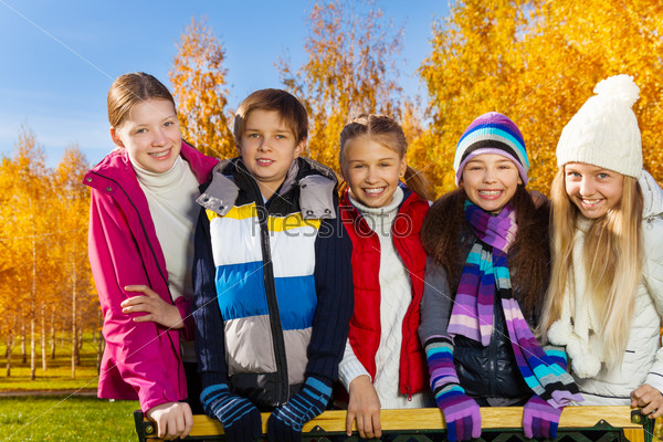 Teen kids in autumn park