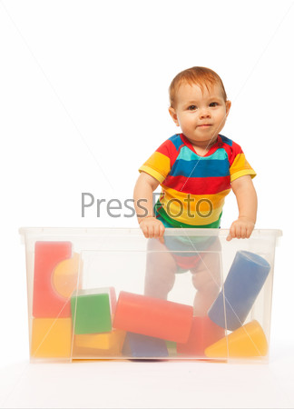 Toddler in box with toys
