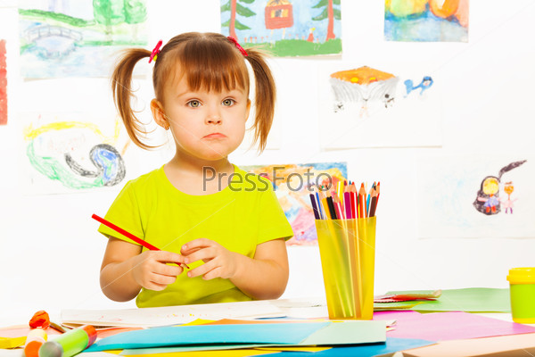 Sad little girl with pencil