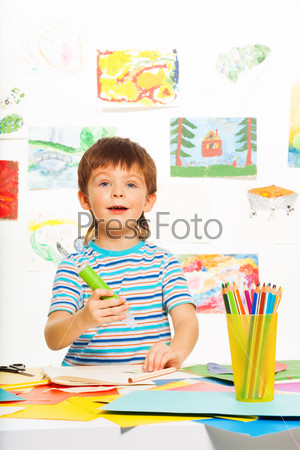 Boy with glue stick and pencils