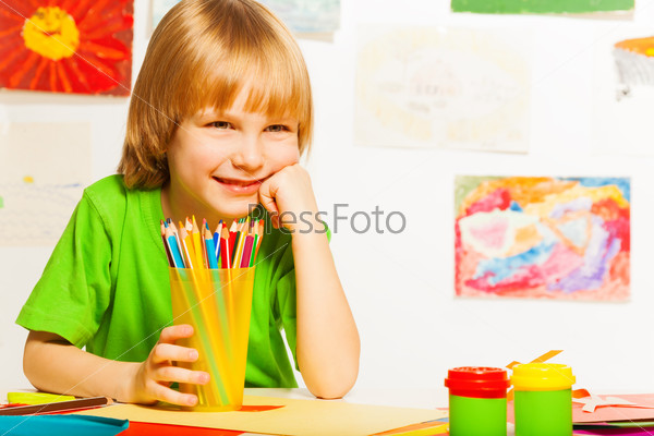 Nice boy with pencils