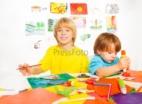 Boys cut draw and glue