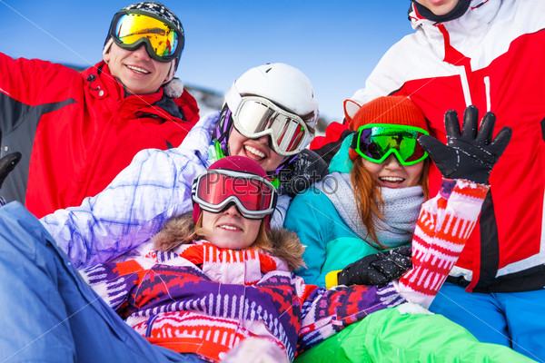 Group of smiling snowboarders having fun