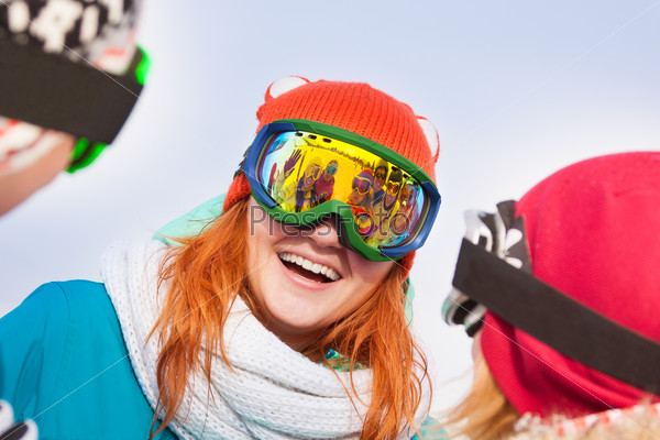 Excited young woman in ski mask