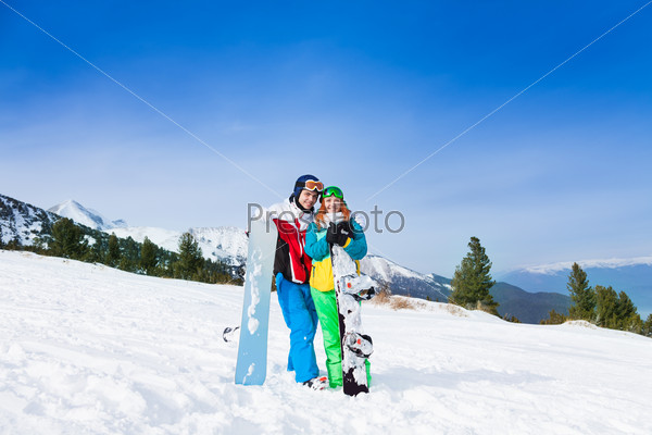 Happy couple in ski masks standing together