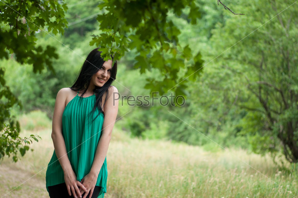 Young beautiful girl on a walk in the country
