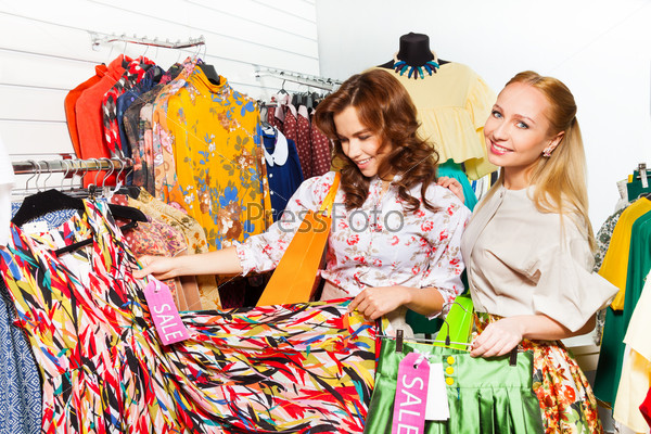 Two women in showroom choosing clothes